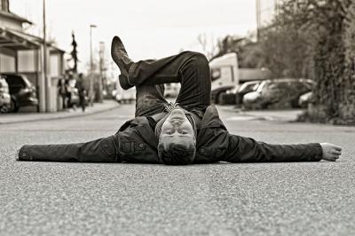 man lying in street